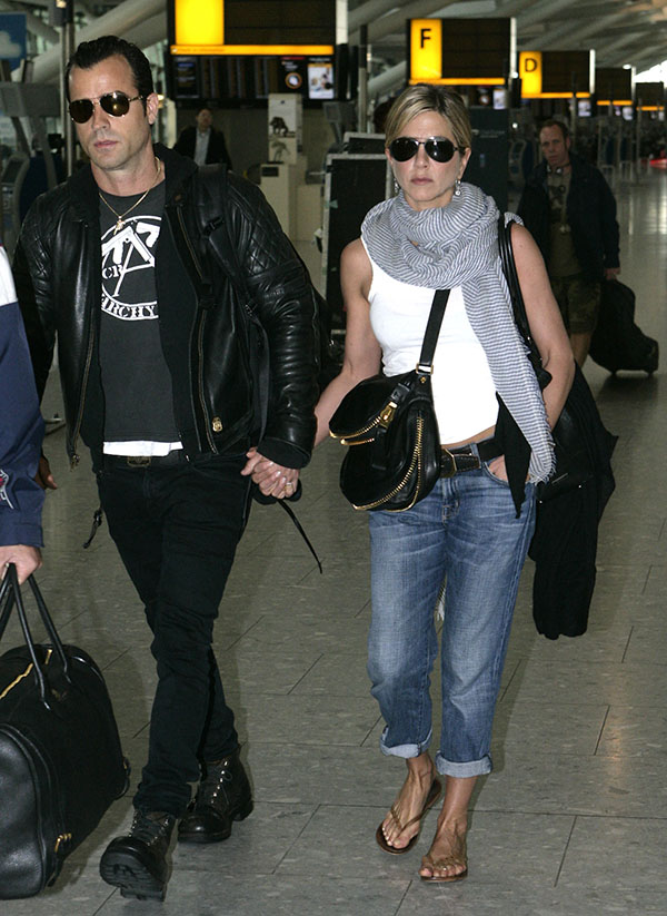 Jennifer Aniston Holds Hands With Justin Theroux at Heathrow